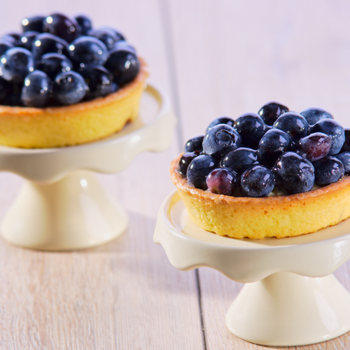 Kleine taartjes met blauwe bessen